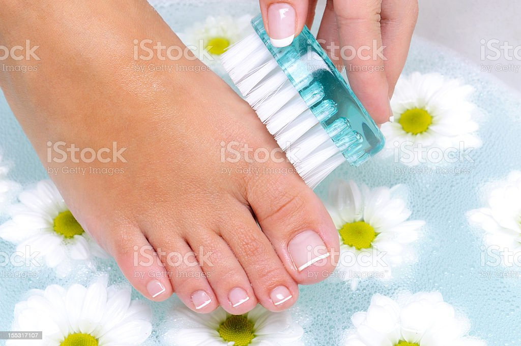 female washes and cleans the toenails royalty-free stock photo