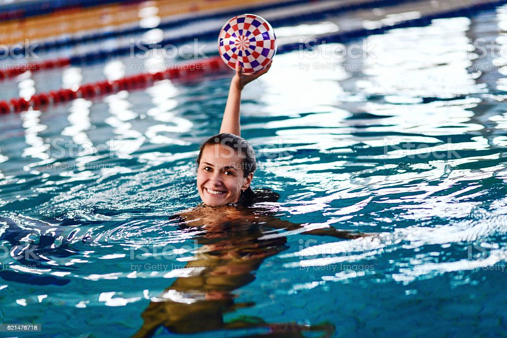 Female Water Polo Player at Indoor Swimming Pool stock photo