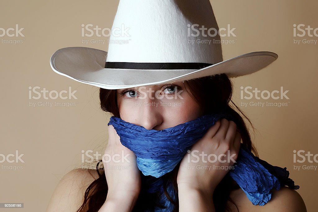 Female wearing a cowboy hat and bandana royalty-free stock photo