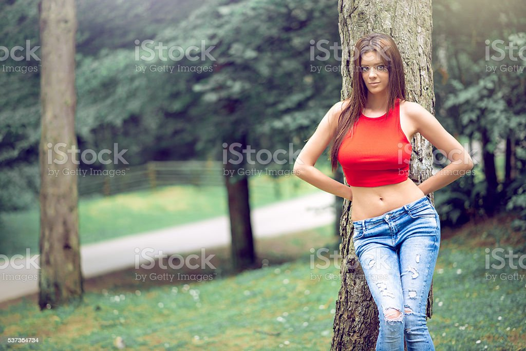 Female wearing jeans in forest stock photo