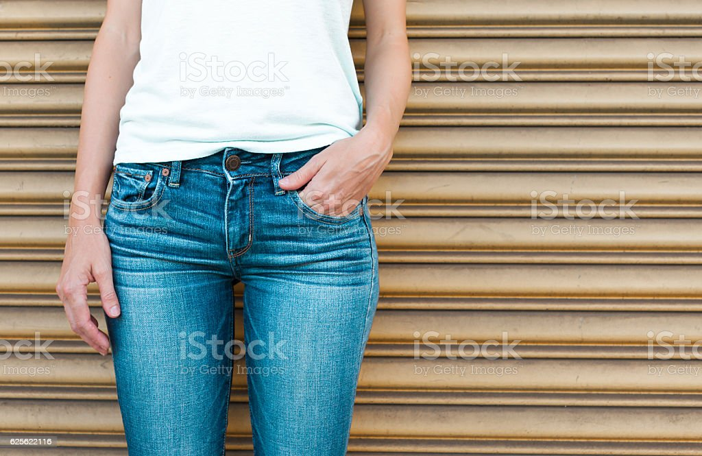 Female wearing jeans stock photo