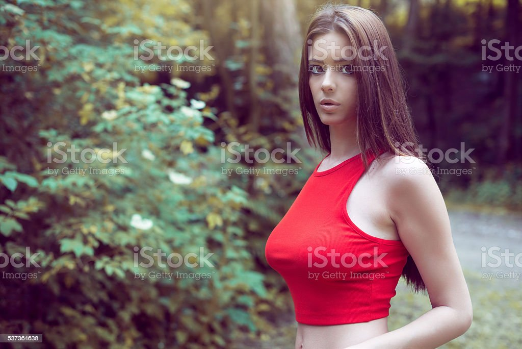 Female wearing top in forest stock photo