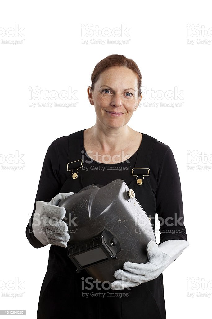 Female welder holding mask on a white background royalty-free stock photo