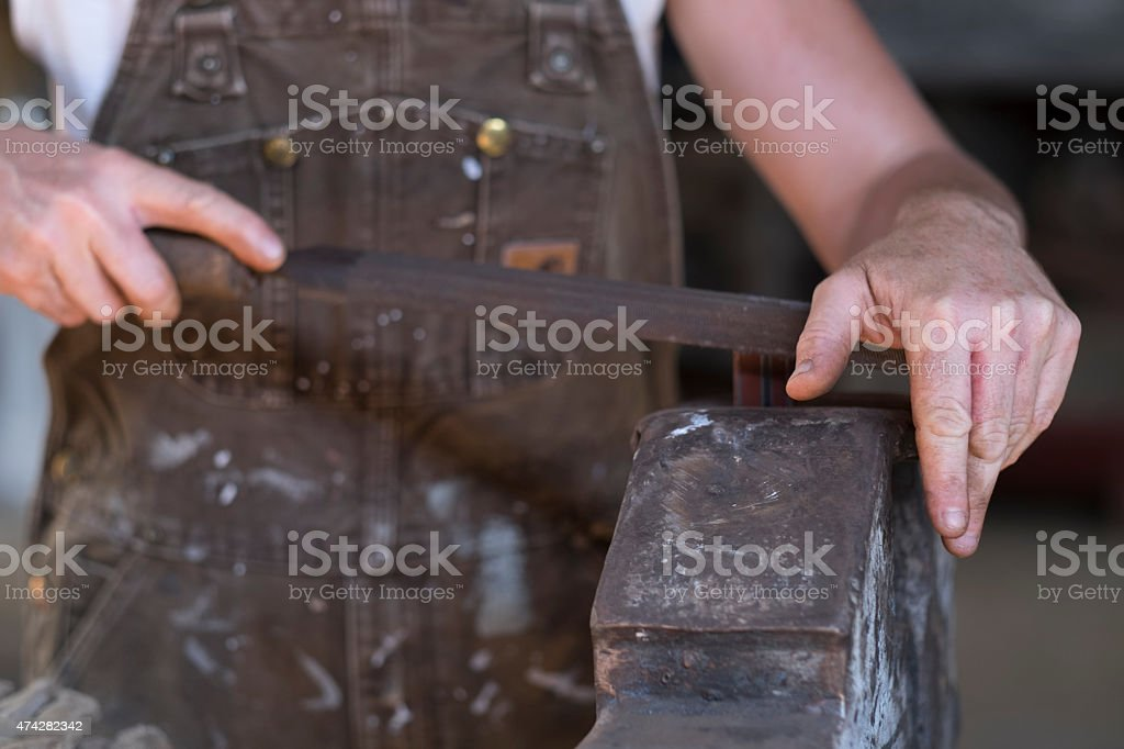 Female Welder in a Metal Shop stock photo