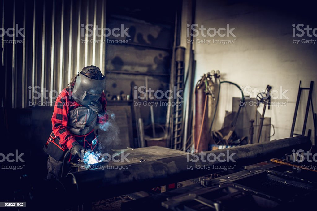 Female welder in workshop stock photo