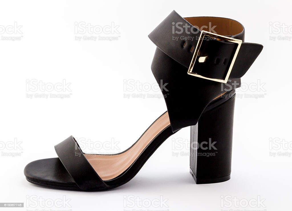 Female wide strapped black high heel sandal isolated on white stock photo