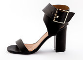 Female wide strapped black high heel sandal isolated on white