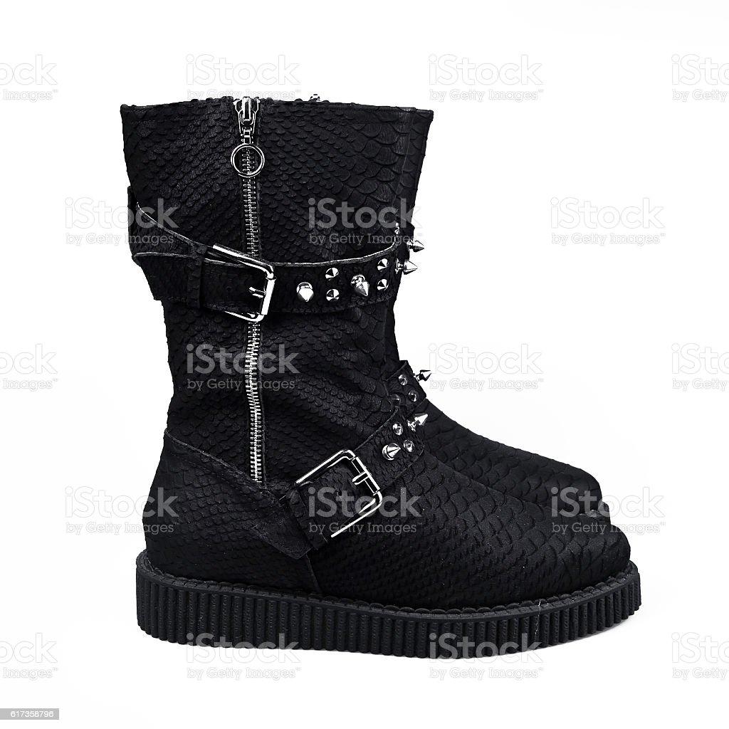 female winter black boots over white stock photo