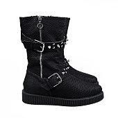 female winter black boots over white