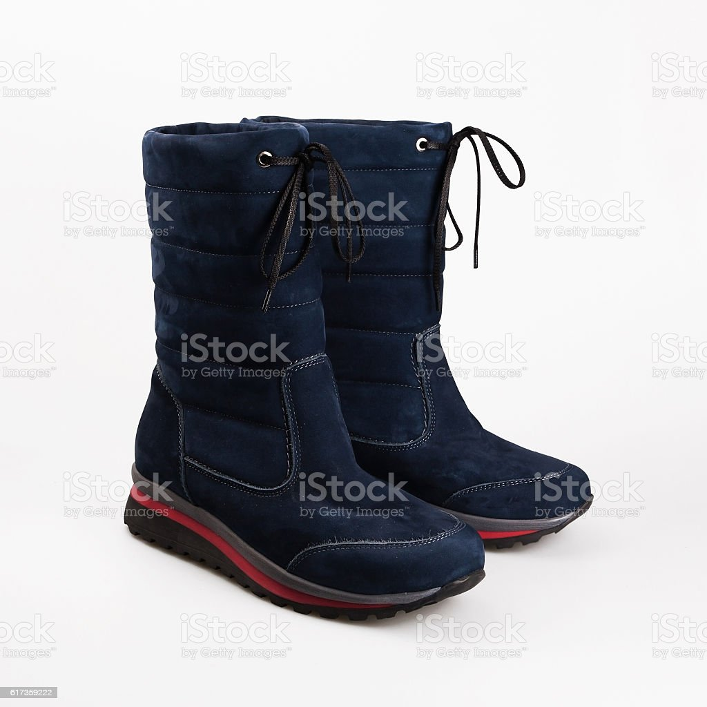 female winter shoes over white stock photo