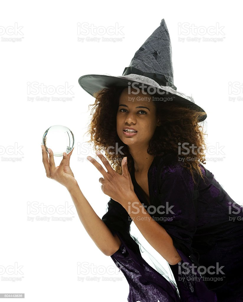 Female witch holding crystal ball stock photo