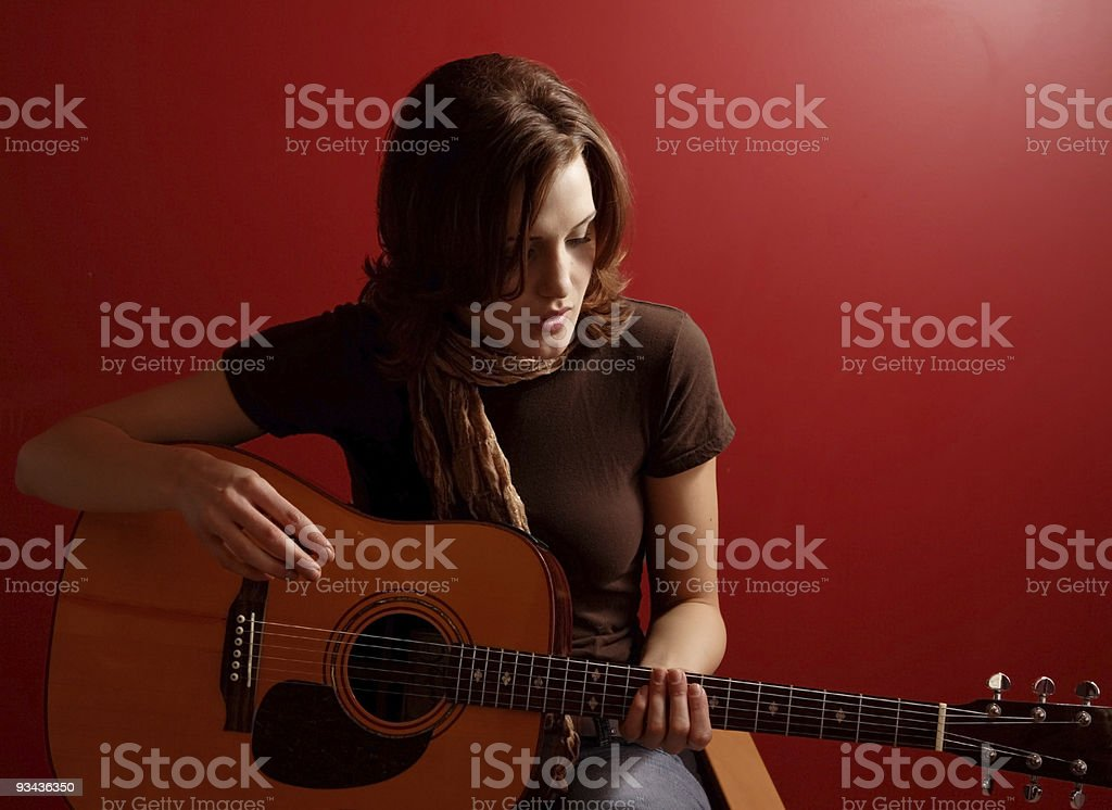 Female with a guitar stock photo