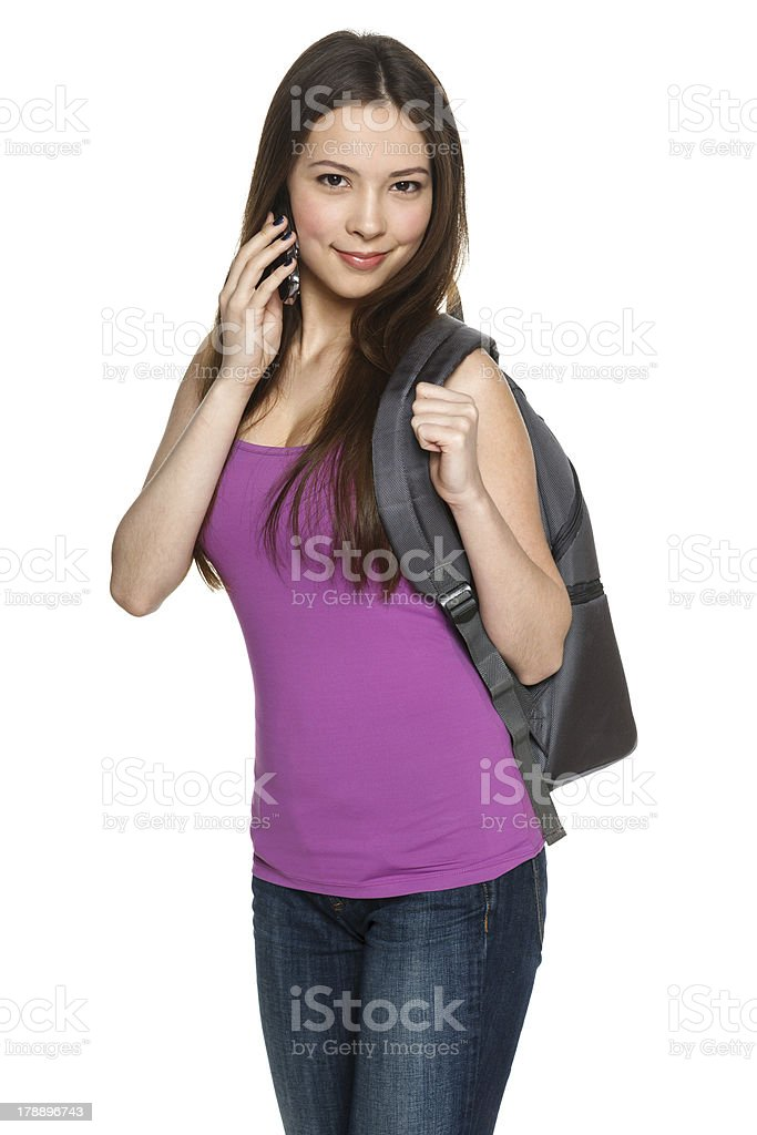 Female with backpack talking on cell phone royalty-free stock photo