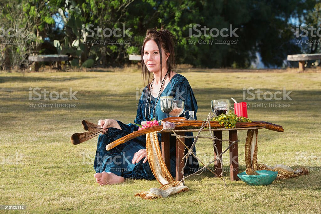 Female with Feathers and Altar stock photo