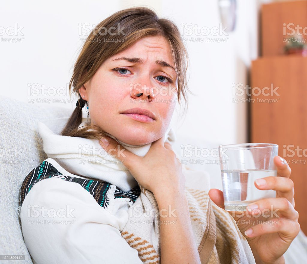 Female with fever at home stock photo