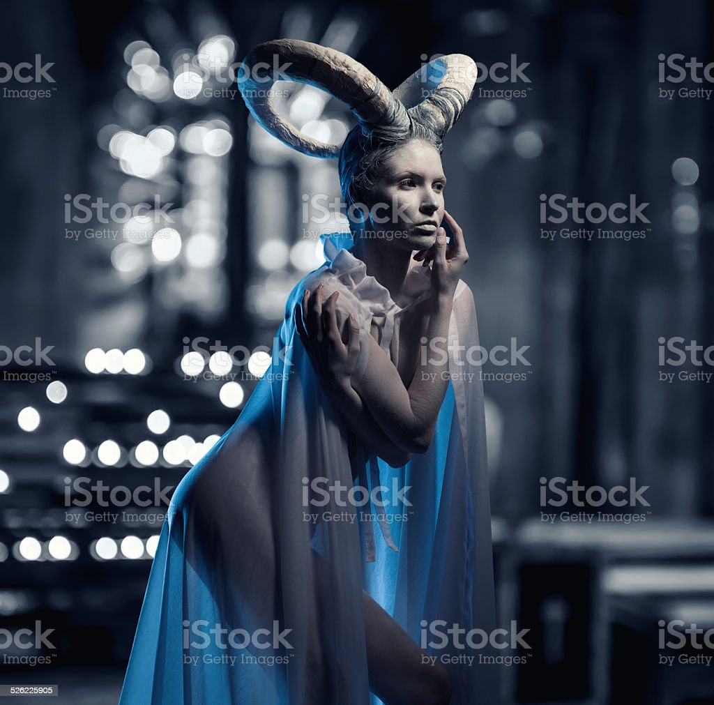 Female with goat body-art stock photo