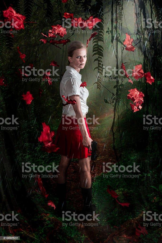 female with handgun stock photo