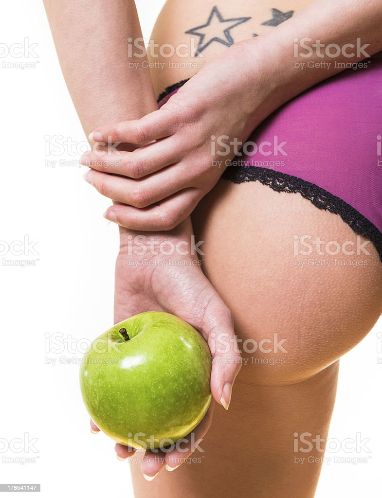 female with nice buttocks and apple in hand royalty-free stock photo