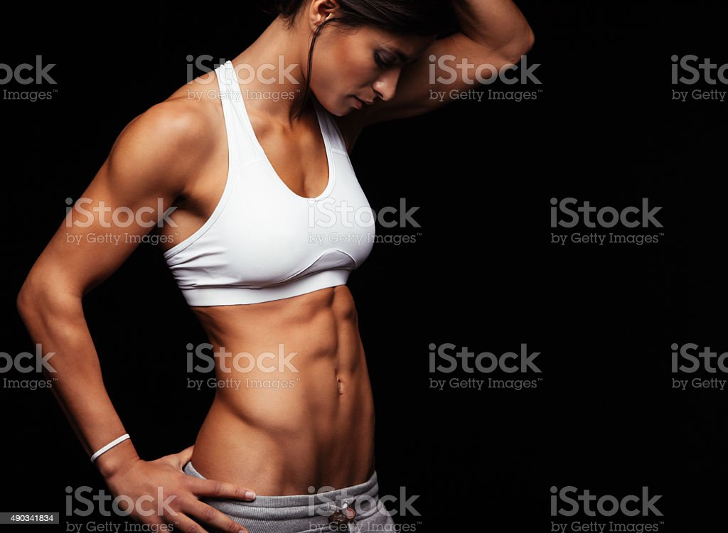 Female with perfect abdomen muscles stock photo