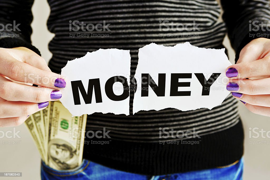 Female with pocket full of dollars tears up Money sign royalty-free stock photo