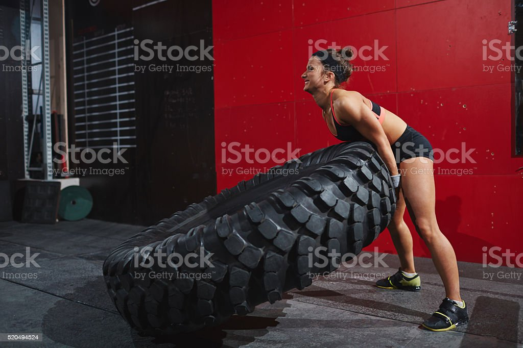 Female with tyre stock photo
