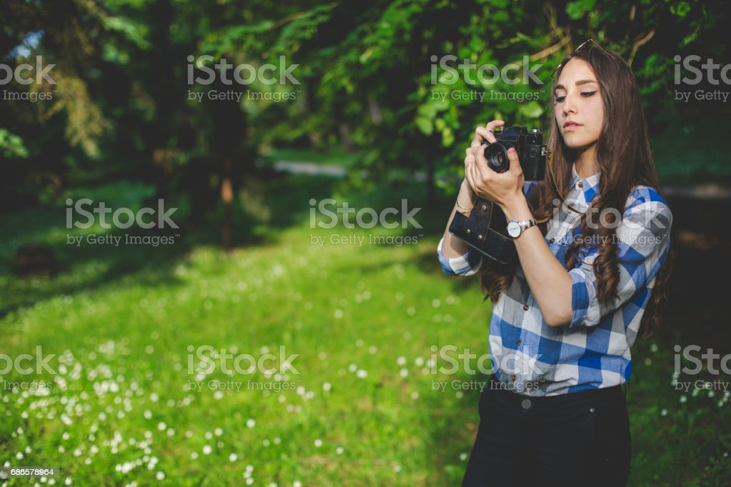 Female with vintage camera in park stock photo