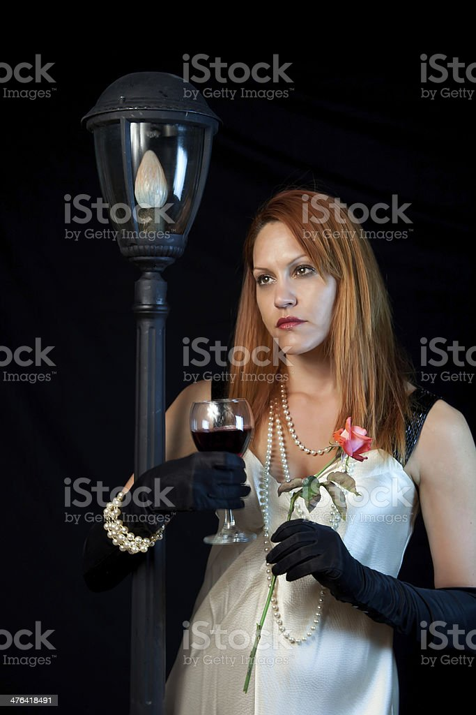 Female With Wine And A Rose royalty-free stock photo