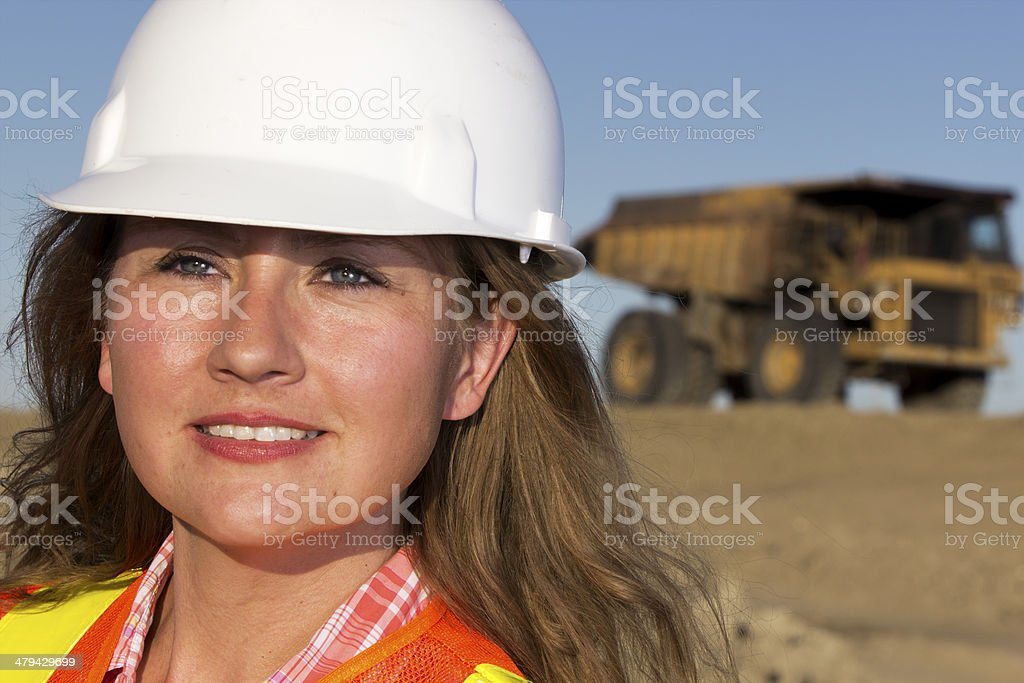 Female Worker and Dump Truck stock photo