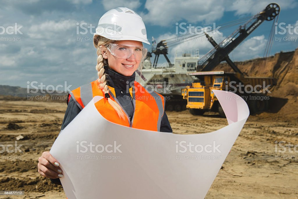 female worker at an open pit stock photo