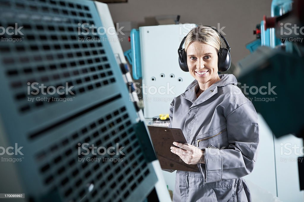 Female worker at printing plant stock photo