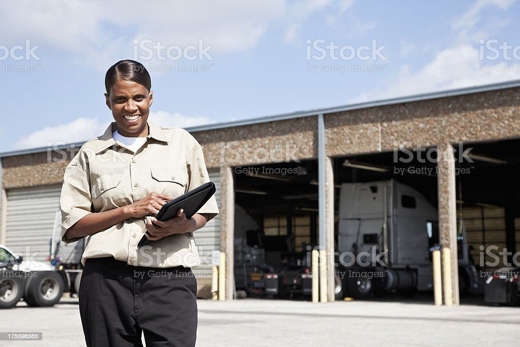 Female worker at trucking facility royalty-free stock photo