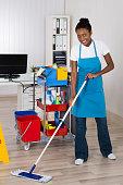 Female Worker Cleaning Floor In Office