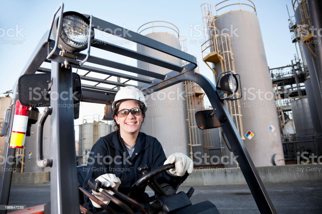 Female worker driving forklift royalty-free stock photo