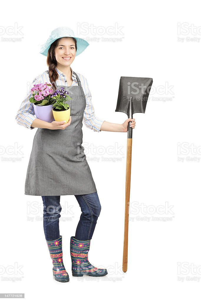 Female worker holding a shovel royalty-free stock photo