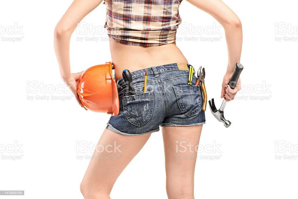Female worker holding hammer and helmet royalty-free stock photo