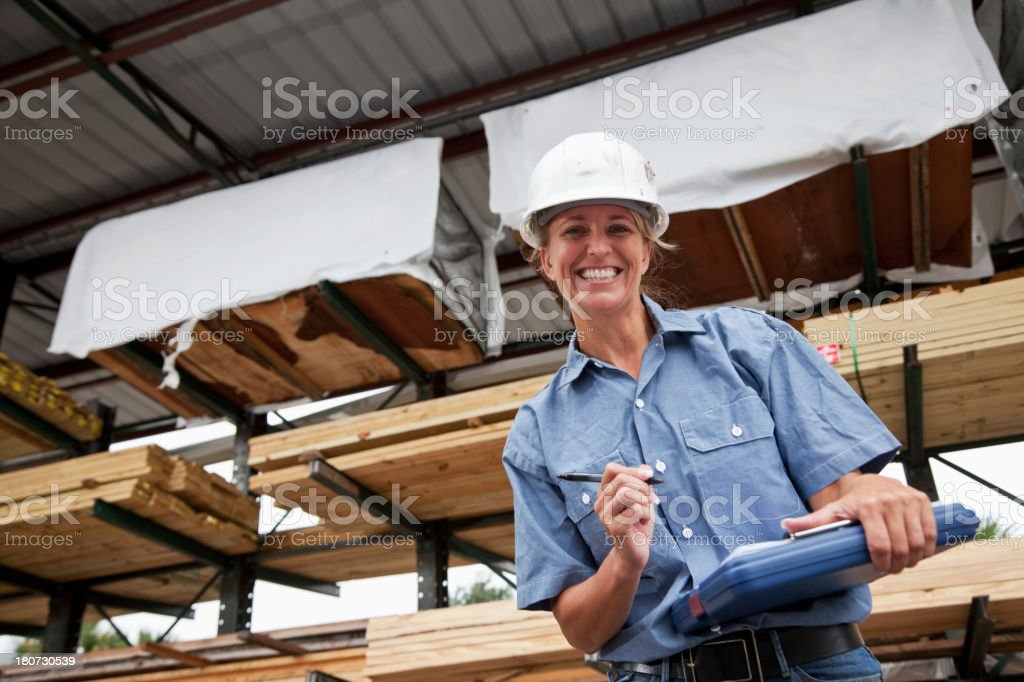 Female worker in lumberyard stock photo