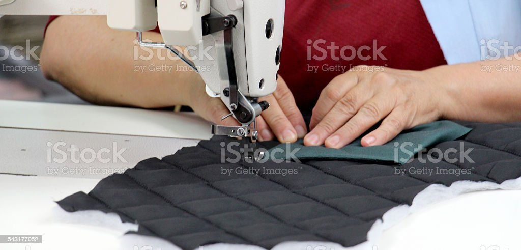Female worker on textile production industry stock photo