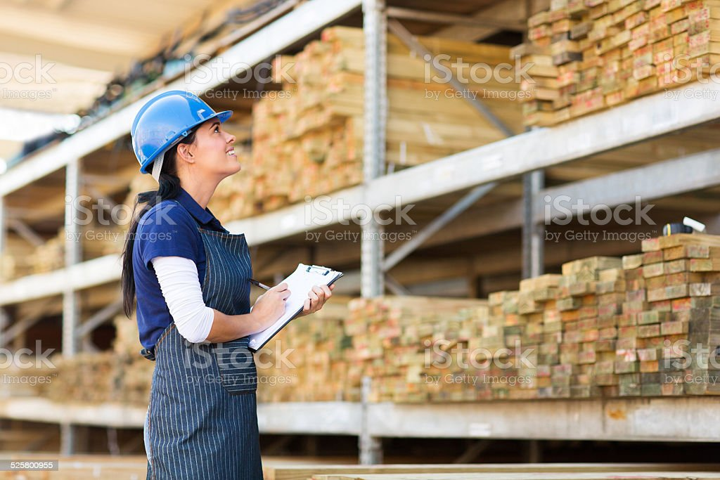 female worker stock taking in warehouse stock photo