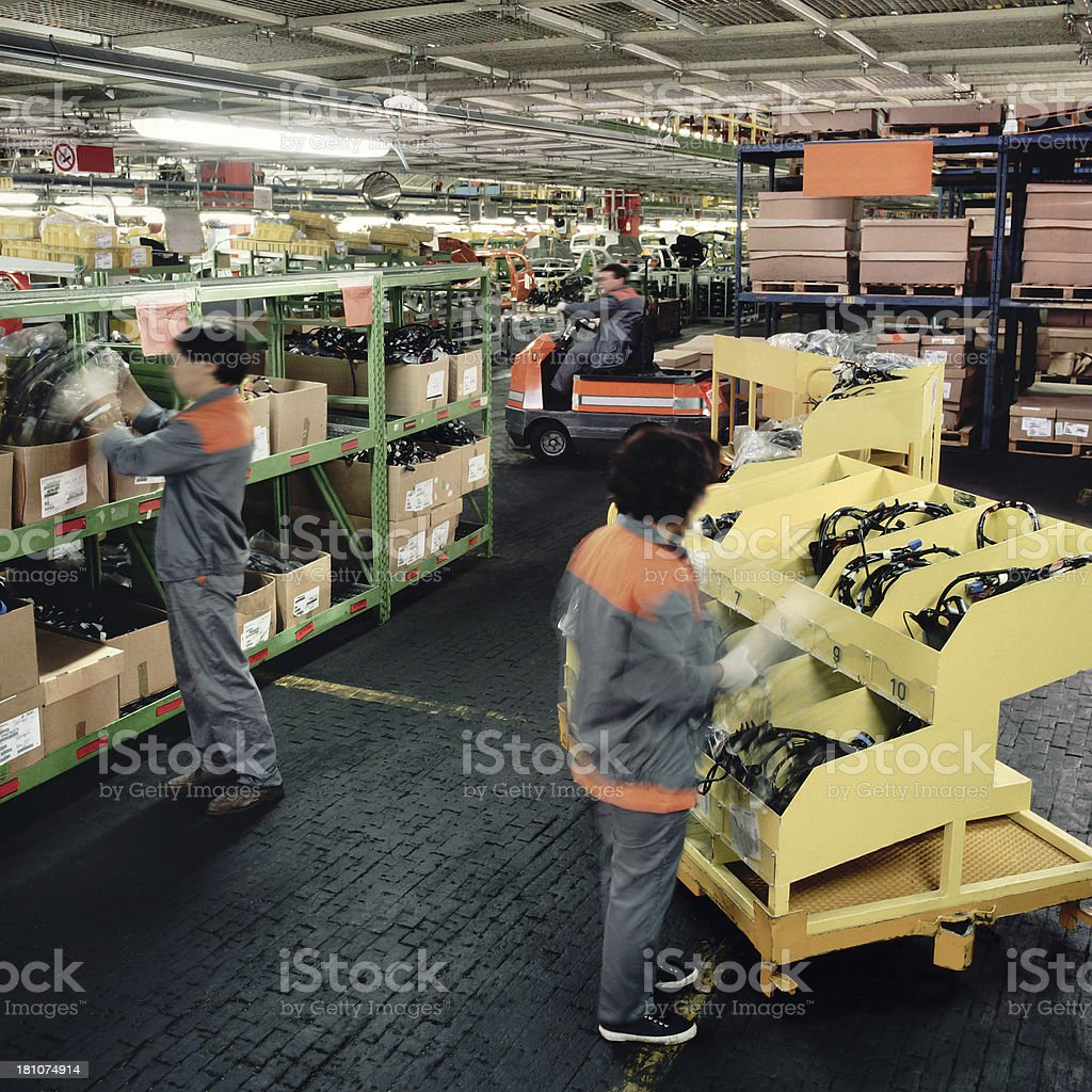 Female workers assembling cables in an automotive factory royalty-free stock photo