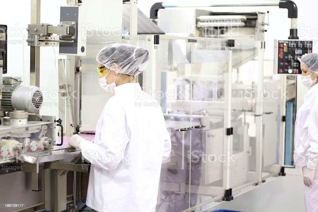 Female Workers At Pharmaceutical Factory stock photo