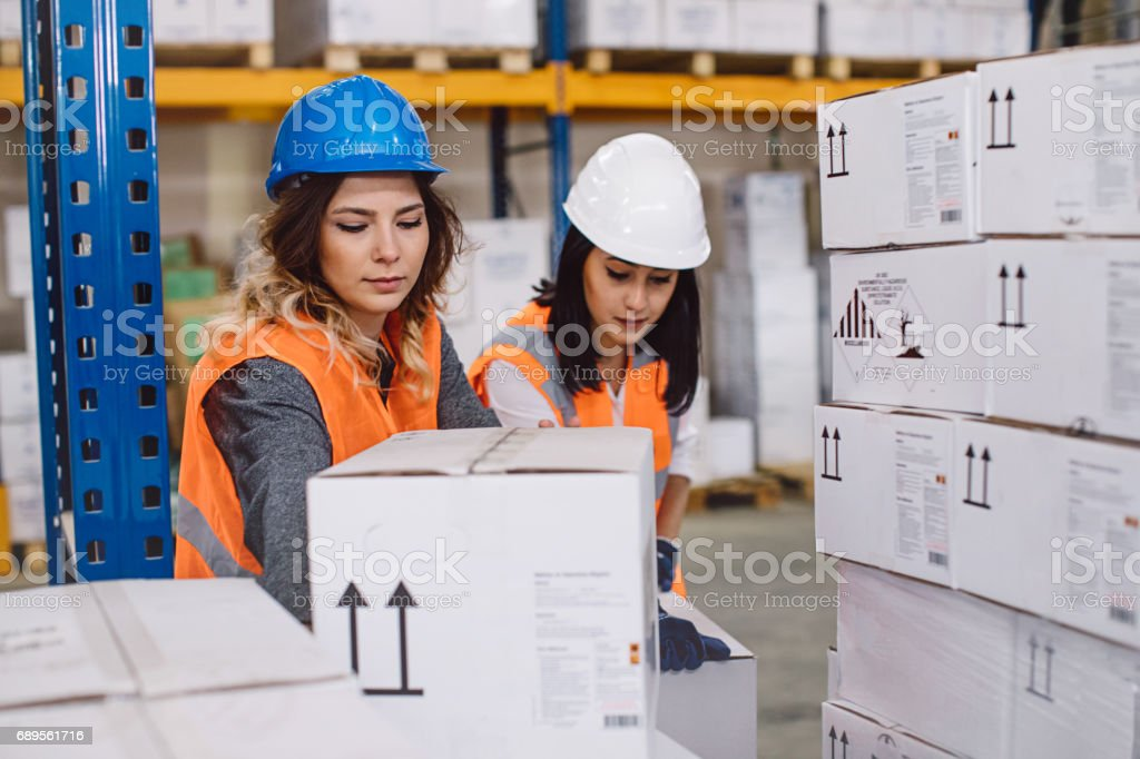 Young two women manager and engineer worker wearing reflective...