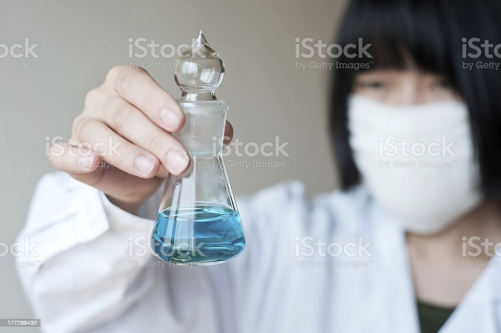 Female workers doing the experiment royalty-free stock photo