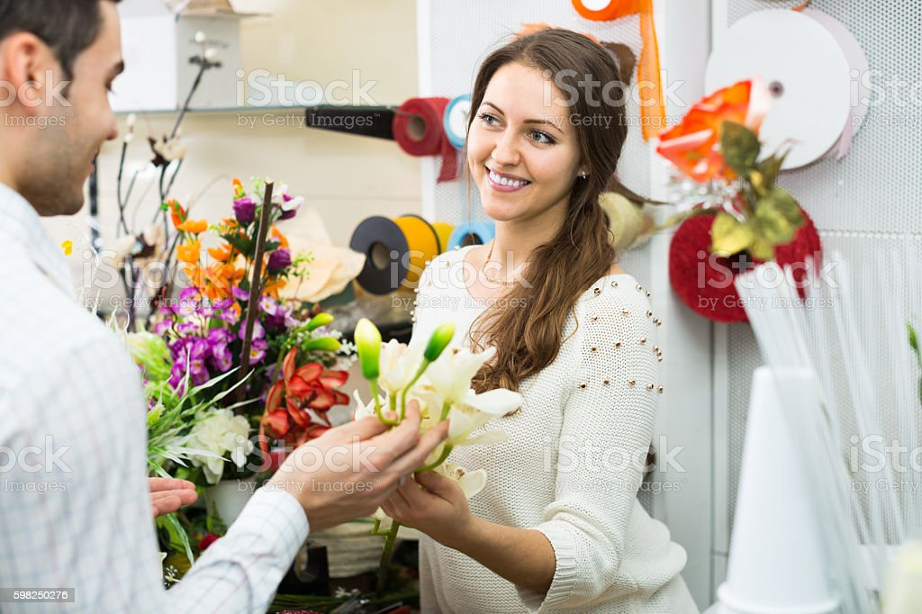 female working in flower section stock photo