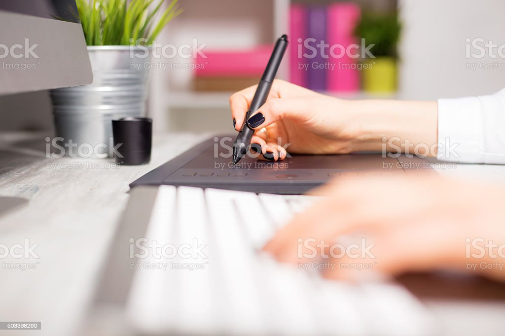 Female working on her drawing pad stock photo