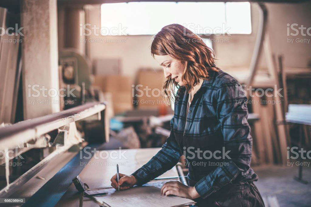 Female working on project in joinery stock photo