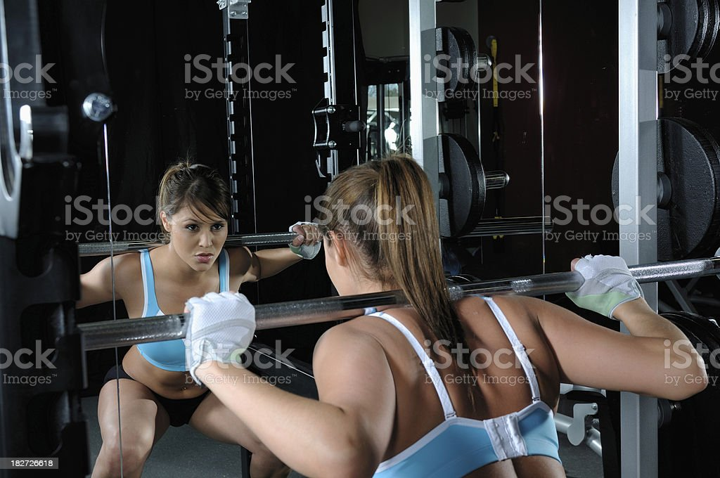 Female working out in a gym royalty-free stock photo