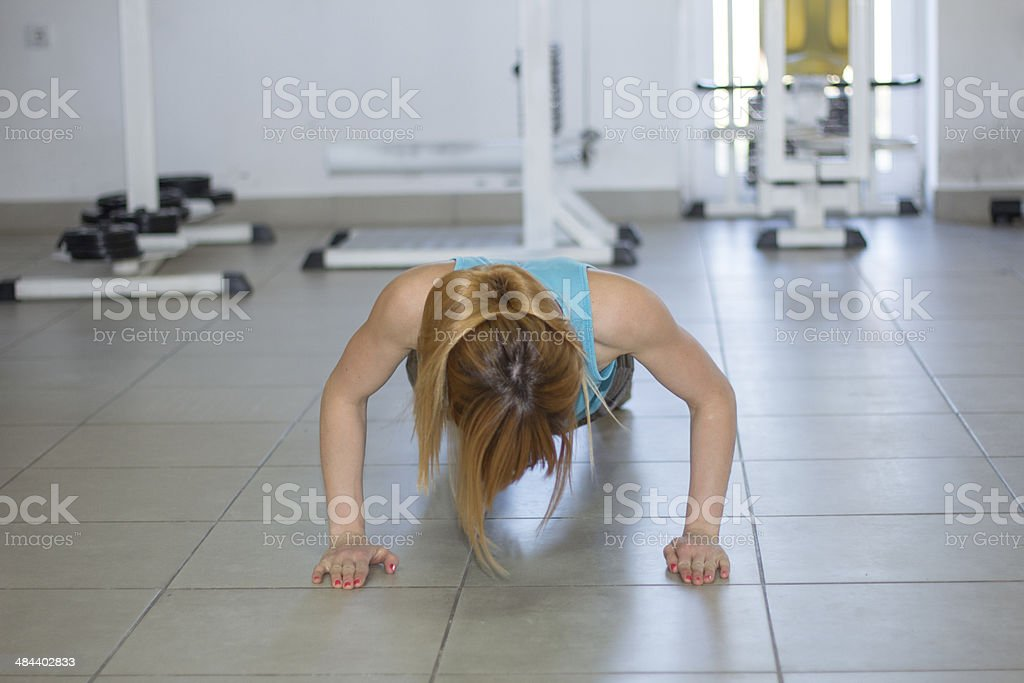 Female working out in fitness club royalty-free stock photo