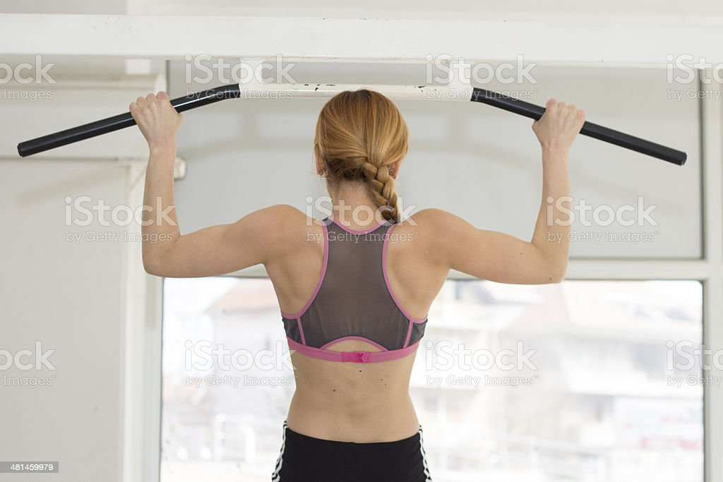 Female working out pull ups royalty-free stock photo