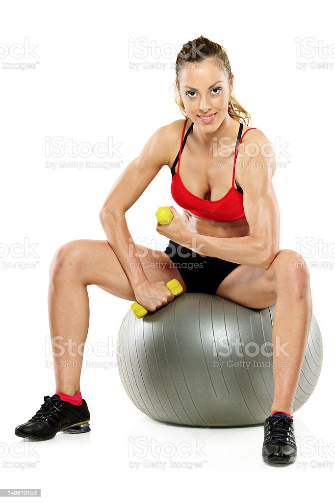 Female working out with a dumb bell royalty-free stock photo