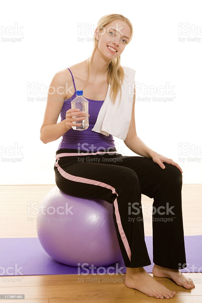 Female working out with an excercise ball royalty-free stock photo